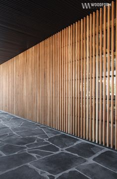 An empty concrete and glass shell was transformed into a warm, highly textural space with extensive use of natural materials including; American white oak, black Spanish marble, off-form concrete and a splash of red furniture. Timber Screens, Timber Slats, Wood Facade, Timber Cladding, Wood Slat Wall, Privacy Fence Designs, Wooden Screen, Stone Flooring, Architecture Design