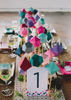 folded paper centerpieces for geometric trend tablescape. Modern wedding inspiration we would love to see here at The 360 at Skyline! Paper Centerpieces, Modern Wedding Centerpieces, Wedding Table, Diy Wedding, Wedding Decorations, Centerpiece Wedding, Centrepieces, Lollipop Centerpiece, Non Floral Centerpieces