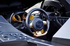 printed steering wheel center cap in the CARESTO ARKHAM CAR now active in the Gumball 3000 race :-) by Lamborghini, Batman Arkham Knight Batmobile, Rallye Automobile, Gumball 3000, Super Cars, Racing, Climate Control, Image Search, Real Life