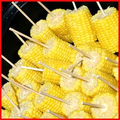 Corn Cob on a stick, easy handling for camping dinner! Peel, break in half, speer with skewer, place in large cooler, cover with boiling water... corn on the cob for a crowd...