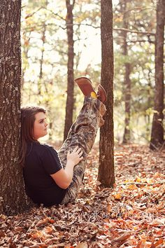 She's a country girl that can rock a dress too! :) Where do you take senior pictures for a girl who likes to hunt? THE WOODS!