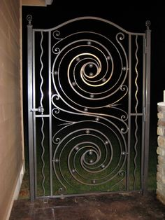 Galaxy Gate--this custom wrought iron gate is full of swirls and spheres. Groovy, right? Featured at the 2009 Show.