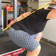 """Sometimes even @coachkimmie needs a reminder!! Working on my 3 points of contact / #neutral #spine for my #squats yesterday in the #garage. I grabbed an old broom & twisted off the stick  to use as my #tactile #coach. This box was only 12"""" tall so that got me pretty low!! #Spinalintegrity #Bodyweight #Squat it out!"""