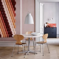 Caravaggio pendant and Caravaggio Wall in a modern nordic setup with classic Arne Jacobsen furniture.