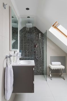 A single full-height wall of tile can have a big impact, whether in a bathroom shower zone or adorning one wall of a powder room.