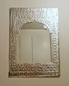 Morrocan style  mirror made out of cardboard and tin foil.