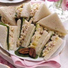 Tuna Tea Sandwiches    •1 can (6 ounces) light water-packed tuna, drained and flaked  •1 to 2 tablespoons mayonnaise  •1/4 teaspoon lemon-pepper seasoning  •4 tablespoons crumbled goat cheese  •4 slices multigrain bread, crusts removed  •4 large fresh basil leaves