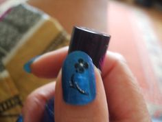 Rimmel Azure with black flowers and a touch of sparkle