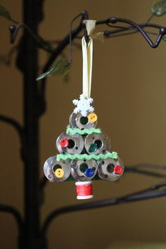 Handmade Sewing Bobbin Christmas Tree Ornament. $7.00, via Etsy.