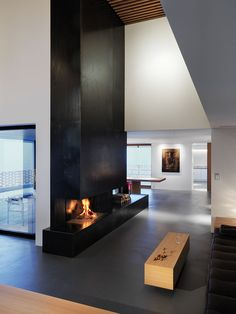 Fireplace Design Idea - 6 Different Materials To Use For A Fireplace Surround // This vertical black steel fireplace surround gives a modern, industrial feel to a room.
