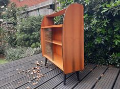 Mid century bookcase / display unit with stylish splayed legs and curved edges by HoneyBadgerFurniture on Etsy