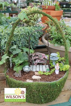 I don't like this fairy garden As much, but I love the mini tiles fill in cracks with soil to make patio.