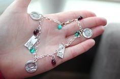 Handmade bespoke charm bracelet with fine silver charms and czech glass beads. Sales support my hedgehog hospital.
