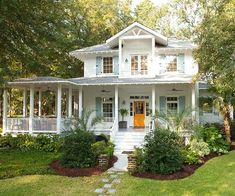I love this house. garden wouldn't work in Canada with those palm trees. Love giant corner porch.