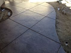 Lancon Plus-Temecula Ca. Sandstone color Roman slate stamped concrete with walnut release and wet look sealant