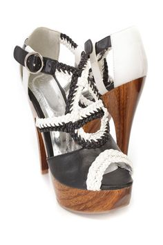 These sexy and stylish platform high heels are a must have! The features include a faux leather upper in a colorblock design, braided strappy design, peep toe, side buckle closure, faux wooden platform heel with a glossy finish, smooth lining, and cushioned footbed. Approximately 5 1/4 inch heels and 1 1/2 inch platforms.