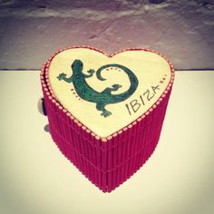 A pink heart shaped wooden box with secret opening, with a hand painted green Salamander by Patricia Romero, artist from Ibiza, Spain. Being the symbol of Ibiza, the Salamander is also a symbol of fire, temptation, and burning desire. ----- About the brand Love'edu: Lov'edu Living was founded by Ibiza raised Anna Boettcher in 2013 in London. Today, Lov'edu is both a physical and an online ethical store that offers unique interior decoration, accessories, jewellery and lifestyle products. All…