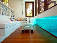 Imagine being able to sit and watch your kids or friends swimming underwater from your couch! So cool!