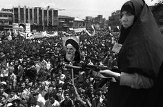 Iranian woman on guard at Khordad - a demonstration against the exile of the leader of the revolution, Ayatollah Khomeini, in one of the main squares in Tehran at the beginning of the Iranian Revolution. Tehran, Iran - 1979. Alfred Yaghobzadeh