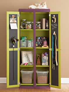 Pet Station        An armoire outfitted with shelves tames pet supplies, while the chalkboard inside the doors displays reminders for playdates and appointments. Spacious, divided compartments provide a manageable way to organize treats, toys, and grooming supplies; each one is tall enough to organize bins and boxes of all sizes- would be great to have this in the laundry room!!