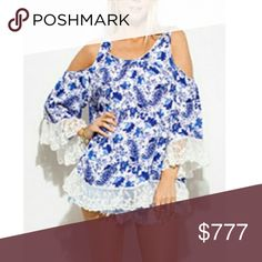 Boho Blues floral cold shoulder top Brand new Boutique item Price is firm   Boho blues floral/paisley print cold shoulder top featuring feminine lace trim at sleeve ends and bottom of blouse. Grab your favorite denim shorts or jeans and you arebready for the day  100%rayon/contrast 70%cotton-30%polyester  Multi colors  Model is 34b wearing the small  Boho bohemian cruise vacation coachella lace cold off shoulder tunic comfortable comfy flower paisley blue white    Tops