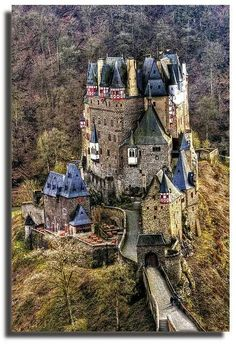 Burg Eltz Castle is a medieval castle nestled in the hills above the Moselle River between Koblenz and Trier, Germany Still owned by a branch of the same family that lived there in the century, 33 generations ago. The Rübenach and Rodendorf families. Beautiful Castles, Beautiful Buildings, Beautiful Places, Chateau Medieval, Medieval Castle, Castle In The Sky, Oh The Places You'll Go, Places To Travel, Places To Visit