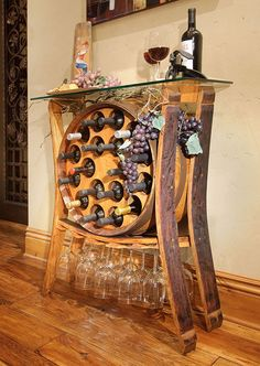 The Wine Barrel Table holds 18 wine bottles and 15 wine glasses stylishly. Bring memories of the Wine Country into your home.  Made in the USA from recycled wine barrels.