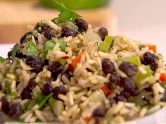 black beans and brown rice / If you are looking to eliminate Red Meat from your diet, this is a healthy alternative.  Packed with protein and extremely filling.   Minus the Antibiotics from Meat..........