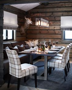 Modern rustic design, wood furnishings, plaid upholstered seating, wood wallcovering, pendant lighting- minus the taxidermy Chalet Design, Cabin Homes, Log Homes, Cabin Chic, Cabin Interiors, Cabins And Cottages, Log Cabins, Rustic Design, Interior Design Living Room
