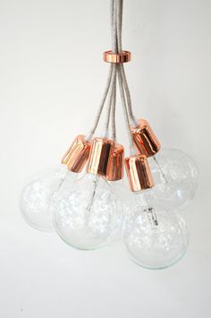 Minimal industrial cable chandelier in many many textile and plastic cables.  Choose your color and pieces of string you need, I offer…