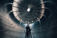 Eliot Ross. Andrew climbs to dizzying heights inside the new bin that he hopes will soon be full of wheat.