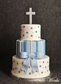 Baby Baptism in Blues - This was for a baby baptism. The party decor was shades of blue with white. The bow and cross are gumpaste.