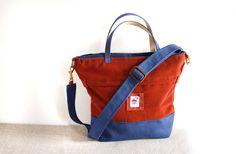 Indigo blue and rust bucket handbag with cross body strap in alcantara and microfiber