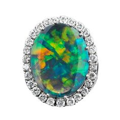 9.10-Carat Black Opal Ring | From a unique collection of vintage cocktail rings at http://www.1stdibs.com/jewelry/rings/cocktail-rings/