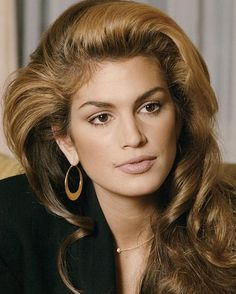 Cindy Crawford's iconic hairstyle with swept waves.Former supermodel had warm brown hair with chunky honey blonde highlights in the 90s.