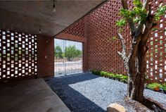 Small Brick House by Tropical Space