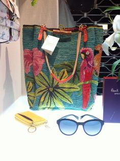 crocheted parrot tote bag from Jamin Puech Paris shown with Paul Smith sunglasses and a key pouch from TUSK.