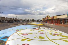 Aurora street mural was created in four days, with 350 volunteers, 180 gallons of paint and tonnes of fun! Now it's one of the biggest murals in Colorado!