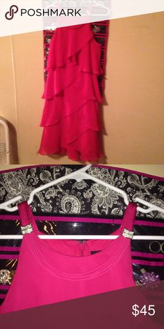 Formal dress. Very fashionable formal dress. Bought at Belk for $90 and worn one time for about 5 hours. Has built on jewelry. It has super cute layers on the whole dress that ties everything together. This is great for any formal occasion you have to attend. SL Fashions Dresses Prom