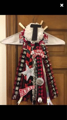Example of a past custom senior garter requested in red, black and silver with band and swimming. Letter T in mum. Unique Homecoming Mums, Letter T, Garter, Red Black, Christmas Wreaths, Swimming, Band, Holiday Decor, Silver