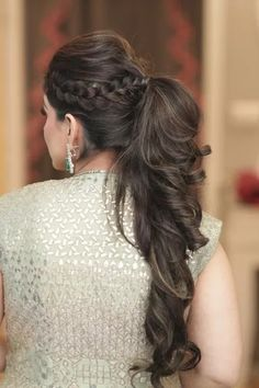 Looking for A curly ponytail hairdo with a crown braid? Browse of latest bridal photos, lehenga & jewelry designs, decor ideas, etc. on WedMeGood Gallery. Long Hair Wedding Styles, Front Hair Styles, Medium Hair Styles, Curly Hair Styles, Pony Hairstyles, Indian Hairstyles, Bride Hairstyles, Mehndi Hairstyles, Lehenga Hairstyles