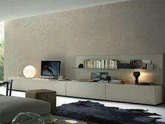 mur beige, meuble basse en bois, tapis peau d'animal, meuble basse télé en bois beige