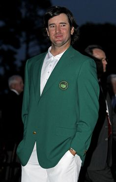 Bubba Watson poses with his green jacket after winning the Masters.