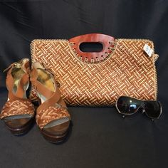 Large Woven Clutch- NWT Made in Indonesia. Wood handles, textured basket weave. Inside lined with black cotton fabric. Zipper enclosure. Brand New with Original tags. Bags Clutches & Wristlets