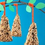 cheerios bird feeder.. now that every school is becoming nut free.. you can use soy butter and cheerios