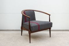 Midcentury chair reupholstered in an antique grey wool blanket.