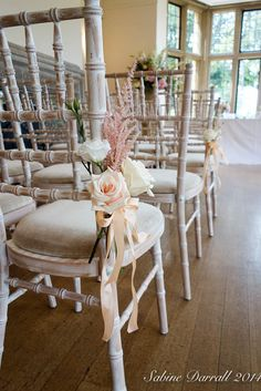 Fresh flowers tied to the chairs on the ceremony aisle - just lovely. Thanks to Sabine of G Lily