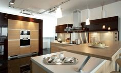 white-modern-granite-countertops-modern-lighting-cream-modern-wooden-kitchen-cabinets