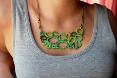 No tutorial, but this crocheted necklace doesn't look like it would be too hard to figure out {from This Way Handmade}