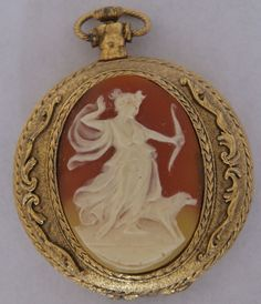 A vintage Max Factor Pocket watch style ladies compact